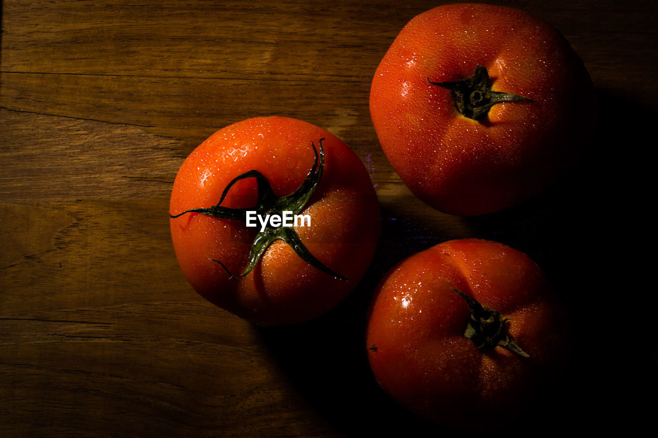 Directly above view of fresh wet tomatoes on table
