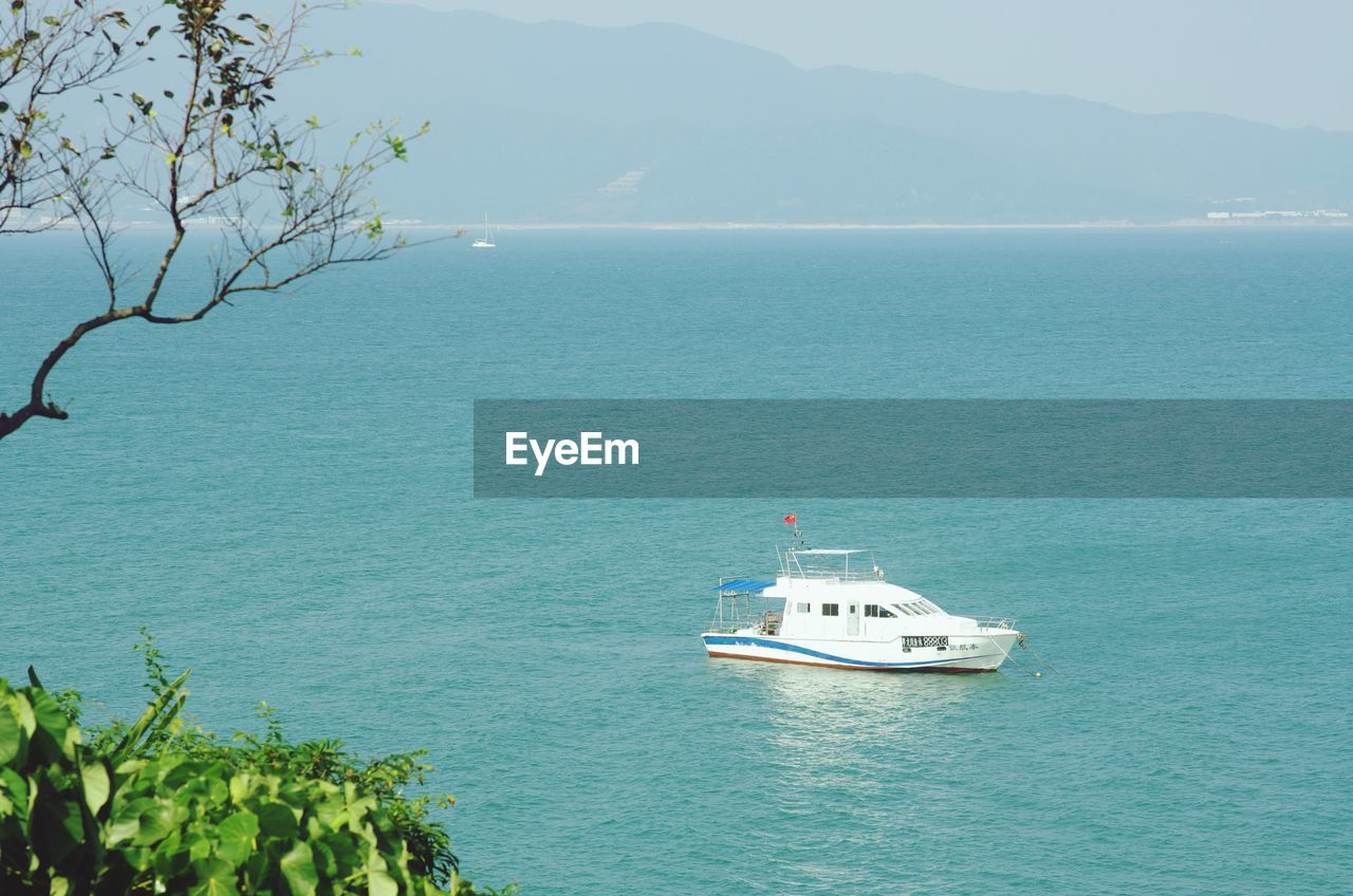 sea, nature, water, scenics, tranquil scene, day, beauty in nature, mode of transport, nautical vessel, tranquility, transportation, high angle view, outdoors, no people, mountain, foreground, tree, horizon over water, sky