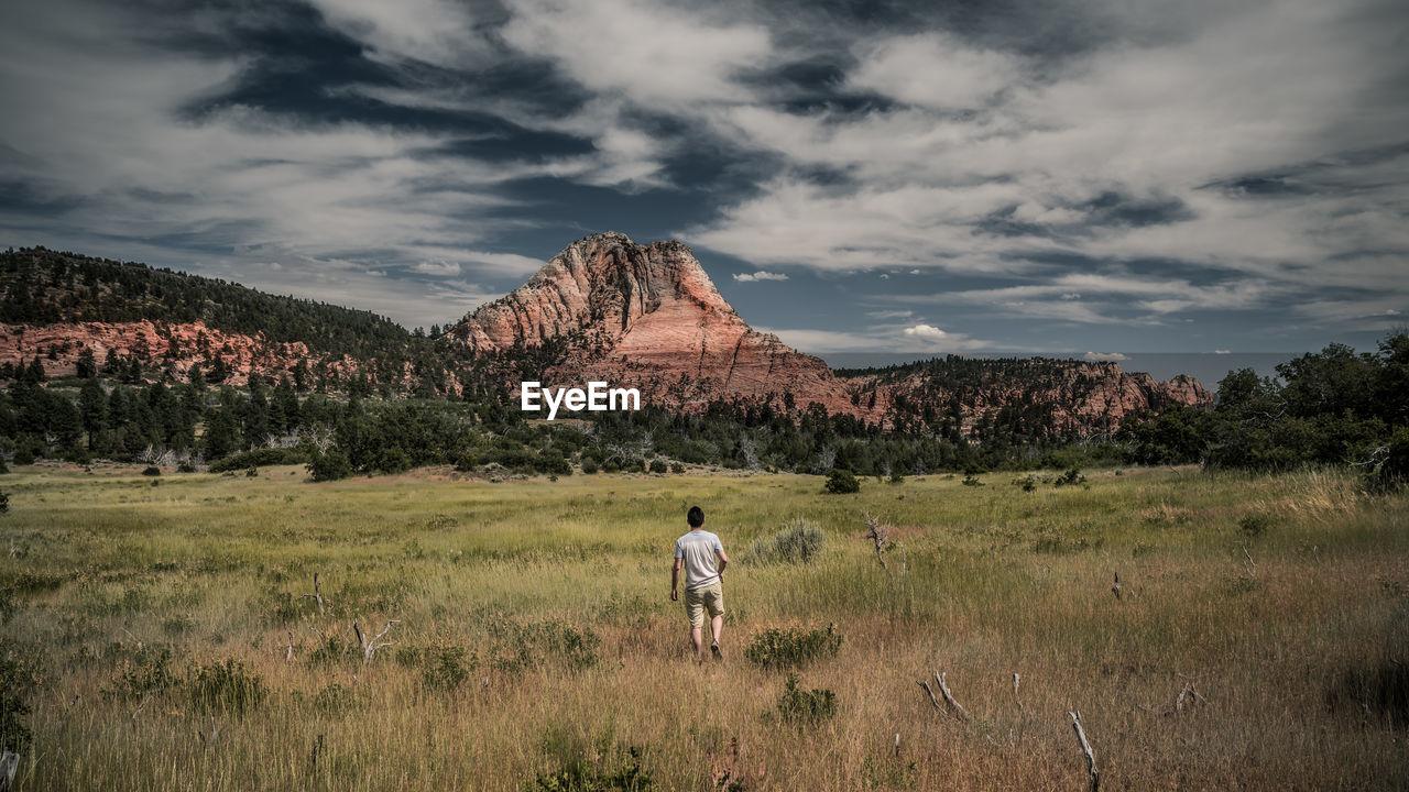Full length of man on landscape against sky