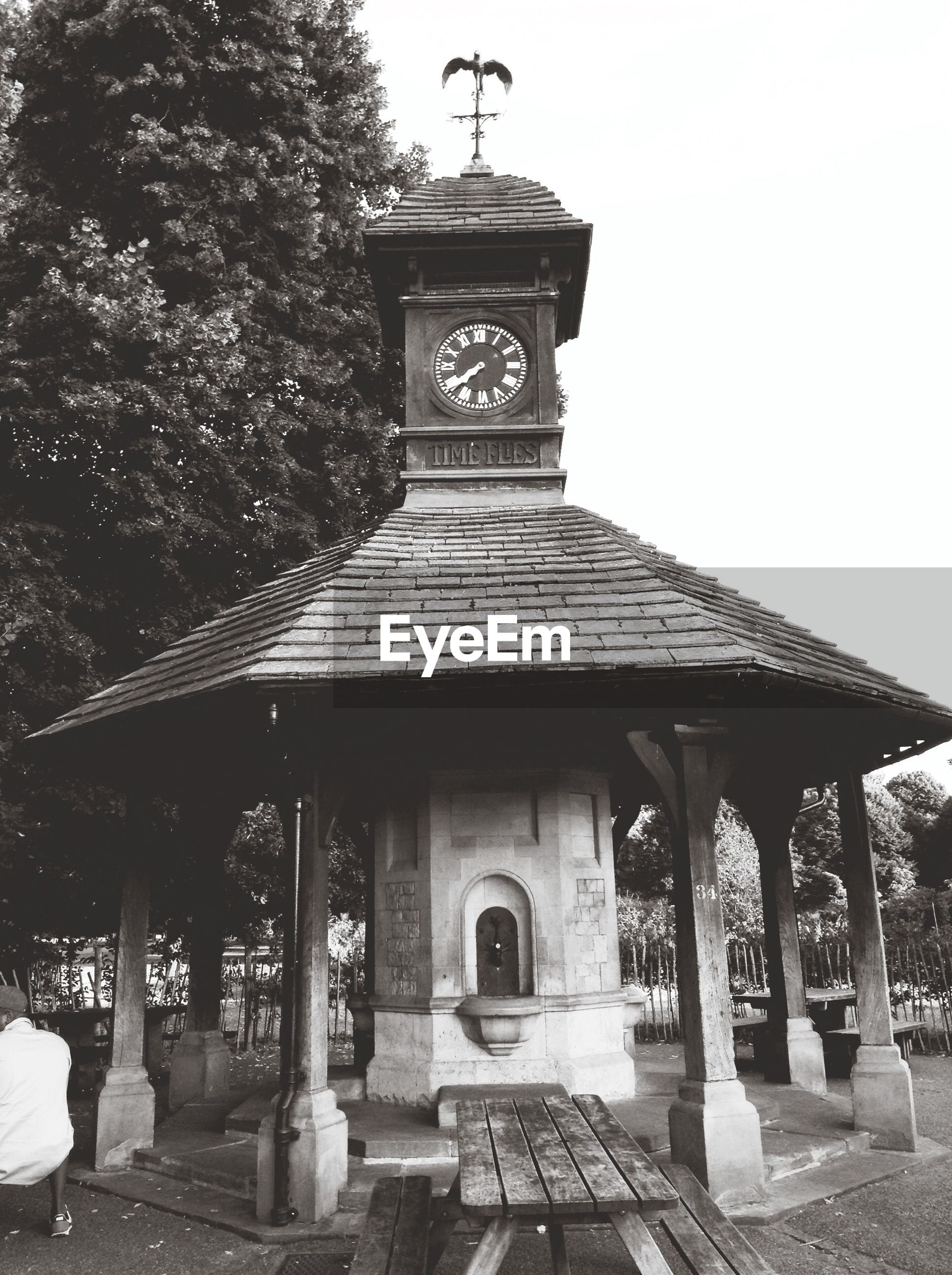 Wooden table next arbor with small clock tower on top