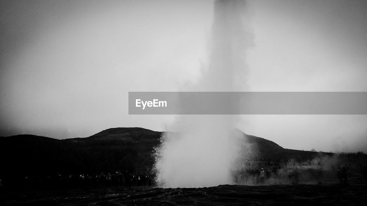 Strokkur geyser against clear sky