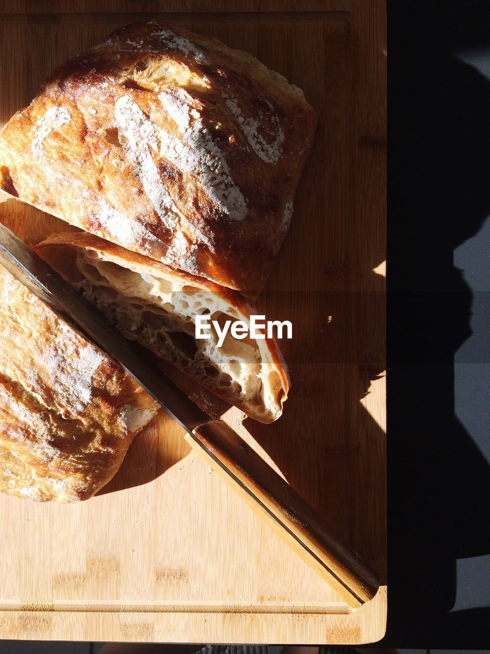 High Angle View Of Bread With Knife On Tray