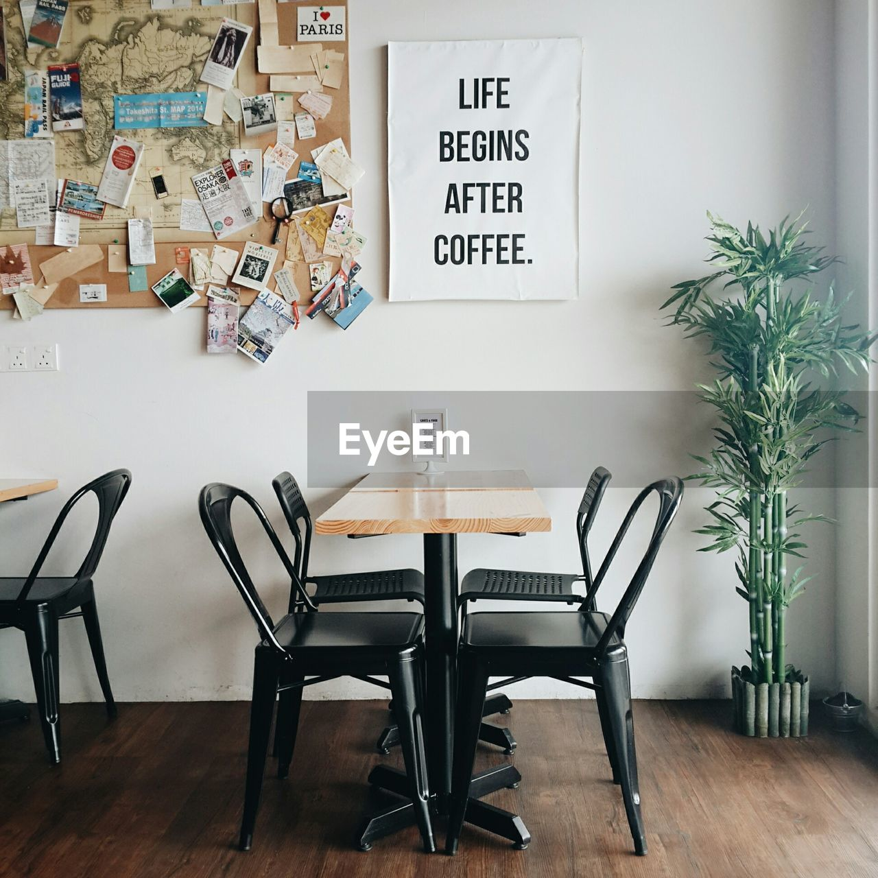 Place setting in cafe against text on wall