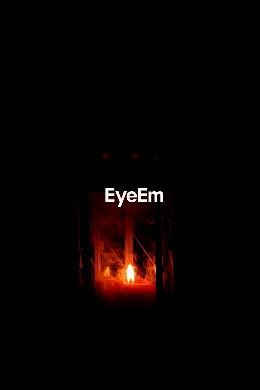 burning, flame, night, copy space, illuminated, glowing, dark, no people, heat - temperature, black background, indoors, close-up