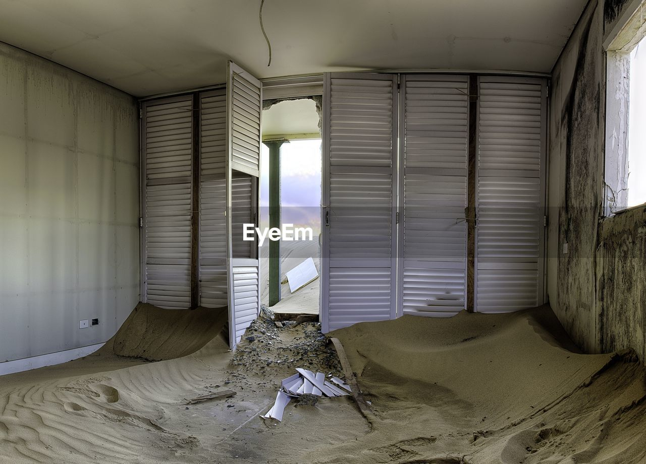 Interior Of Abandoned Home With Sand
