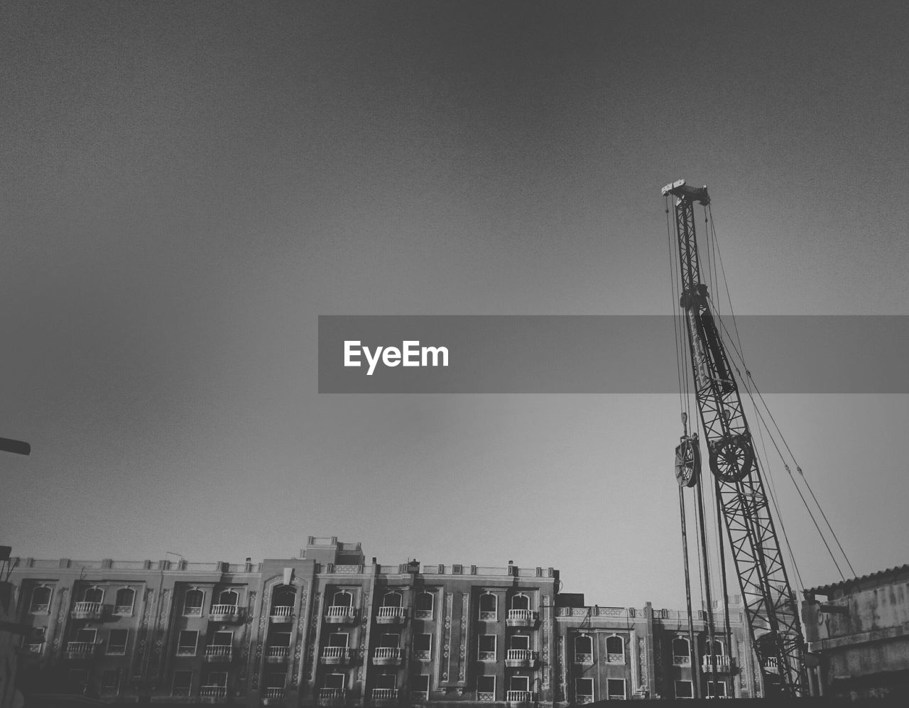 architecture, built structure, building exterior, development, construction site, copy space, low angle view, clear sky, day, industry, no people, outdoors, city, progress, sky