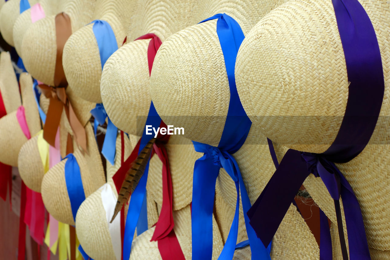 Full frame shot of colorful straw hats for sale at market stall