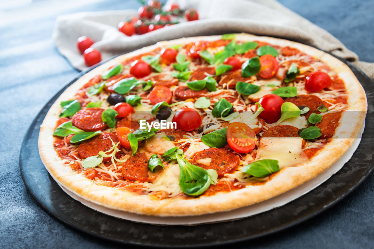 Close-up of pizza served in plate on table