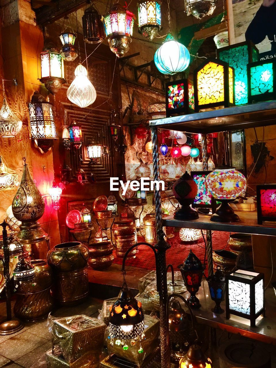 illuminated, lighting equipment, variation, decoration, choice, indoors, retail, no people, large group of objects, hanging, glass - material, for sale, night, business, abundance, arrangement, multi colored, store, christmas decoration, electric lamp, light, christmas ornament, retail display, ornate