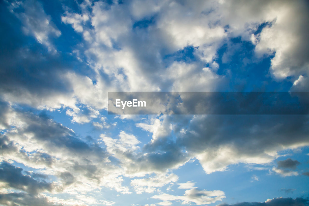 cloud - sky, sky, beauty in nature, low angle view, tranquility, scenics - nature, no people, tranquil scene, nature, blue, backgrounds, day, outdoors, idyllic, cloudscape, full frame, non-urban scene, dramatic sky, sunlight, white color, meteorology