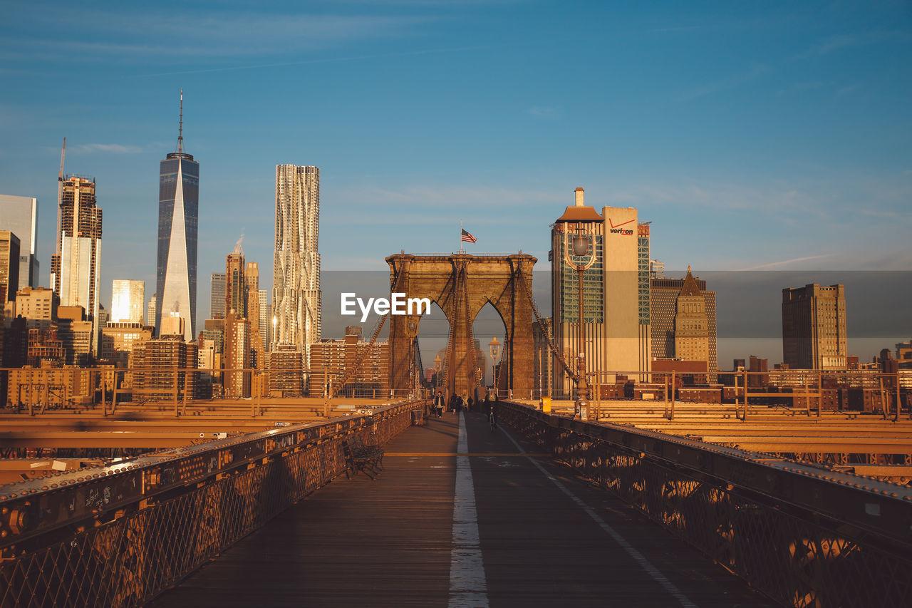 Brooklyn bridge and cityscape against sky
