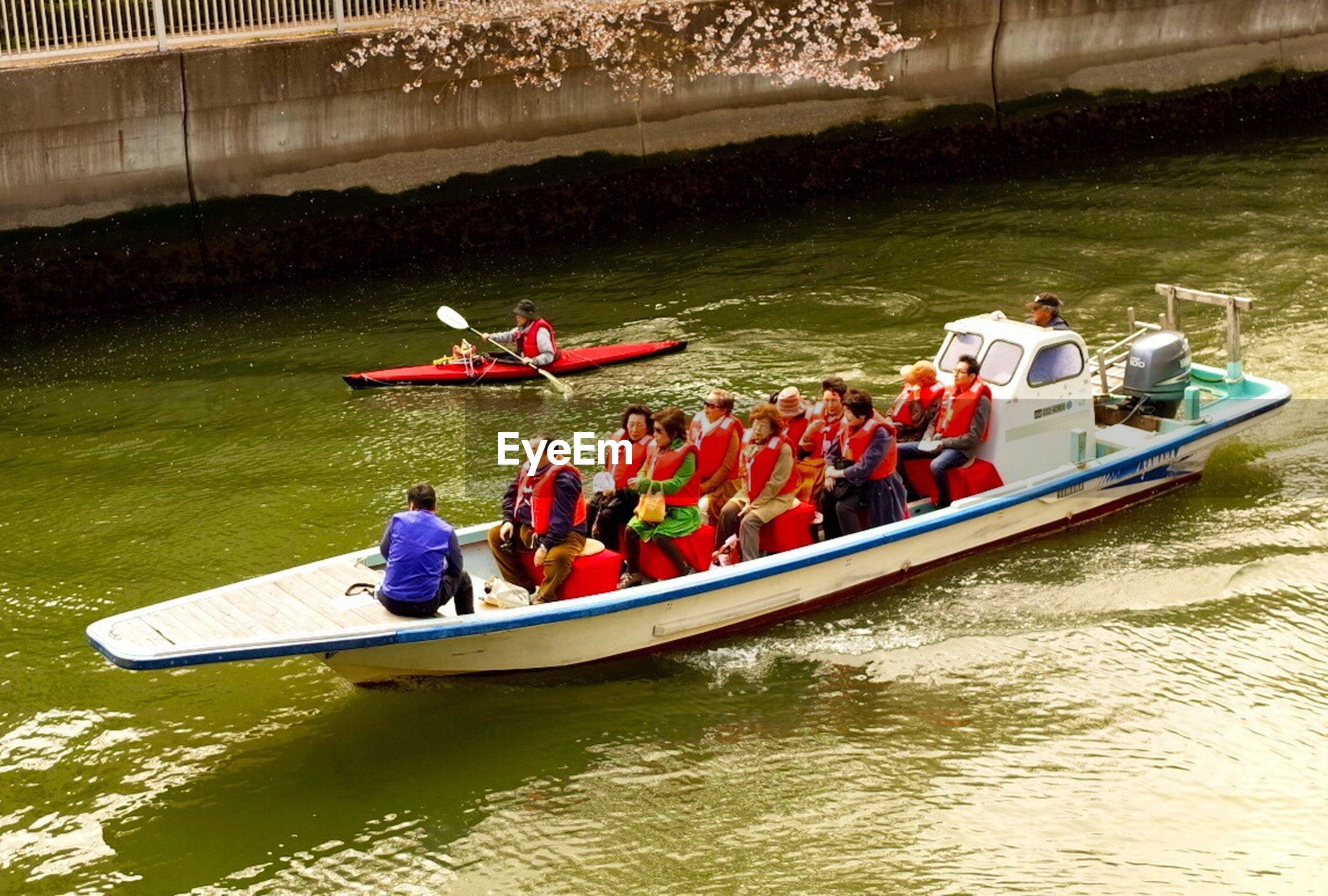 water, lifestyles, men, leisure activity, nautical vessel, transportation, person, boat, sitting, mode of transport, river, large group of people, togetherness, lake, vacations, travel, medium group of people, high angle view