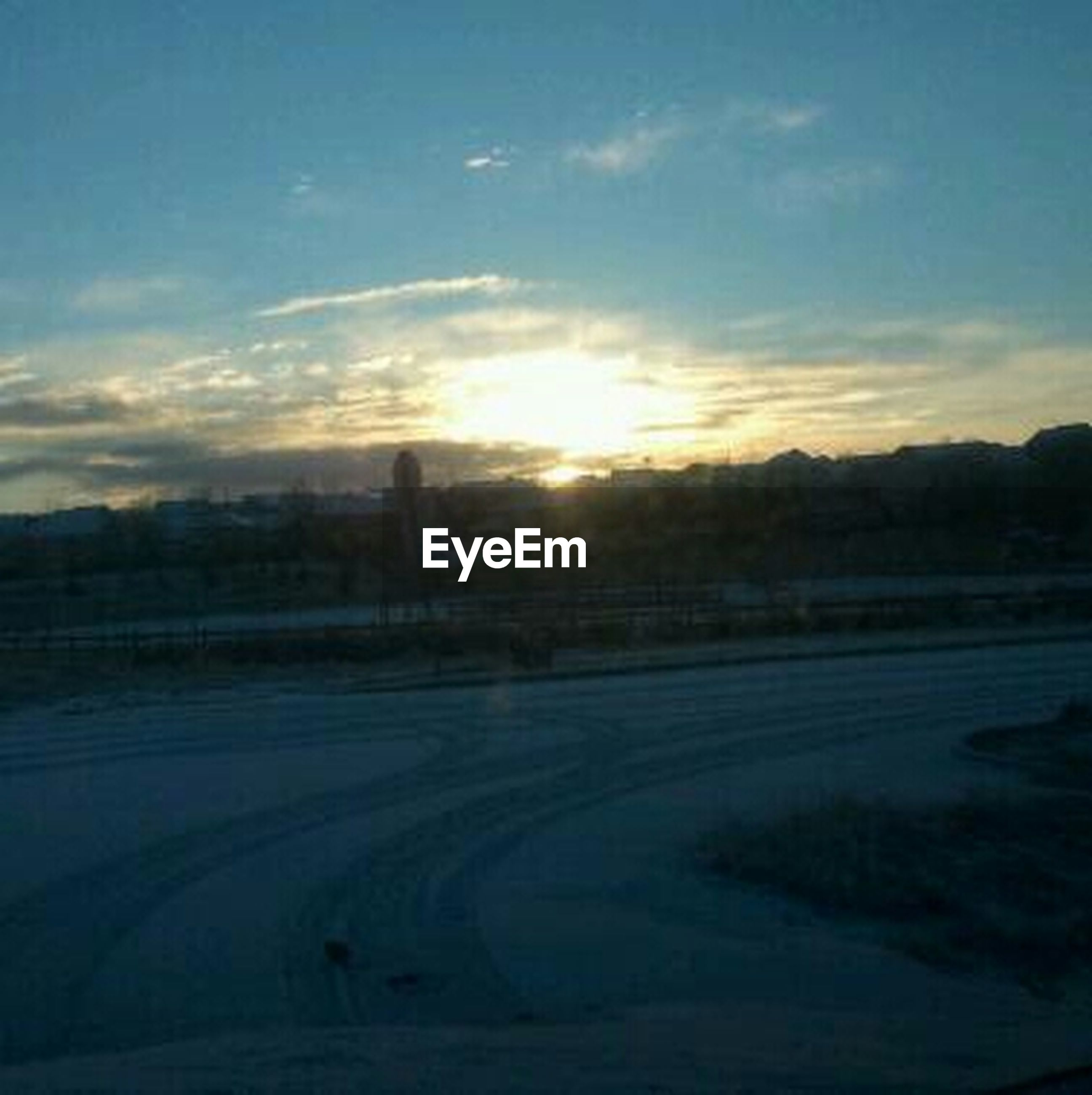 sunset, sky, landscape, scenics, tranquil scene, road, tranquility, beauty in nature, nature, cloud - sky, transportation, silhouette, sun, sunlight, field, idyllic, cloud, outdoors, tree, no people