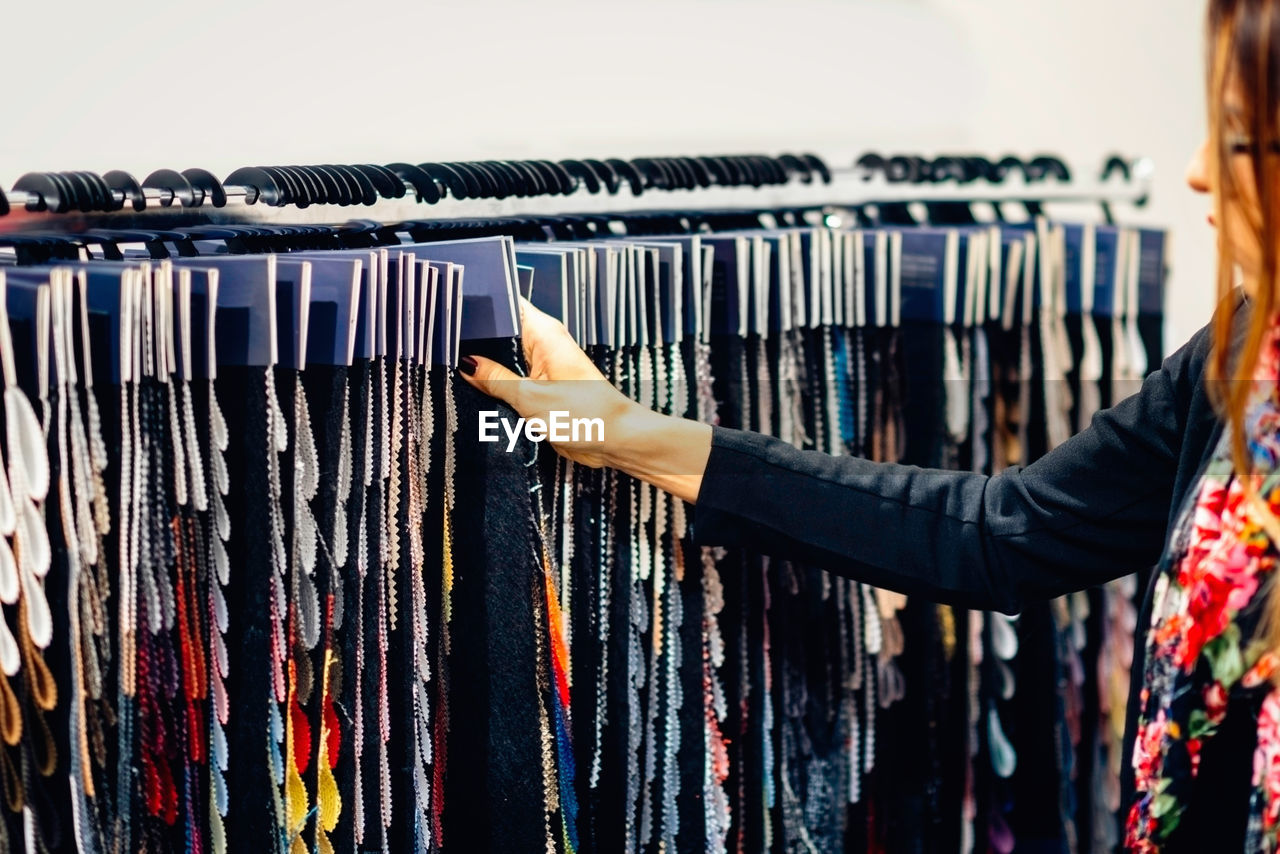 Woman choosing color swatches at store