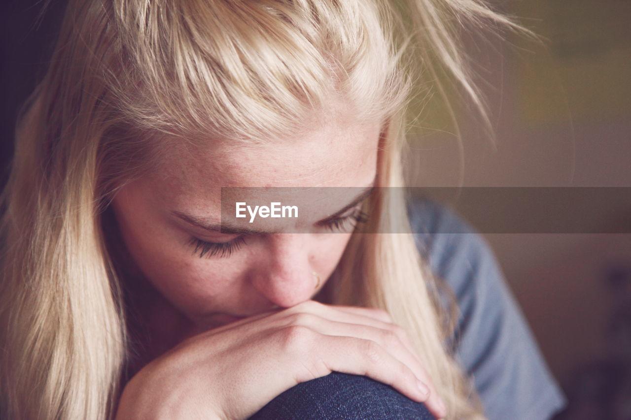 Close-Up Of Sad Young Woman
