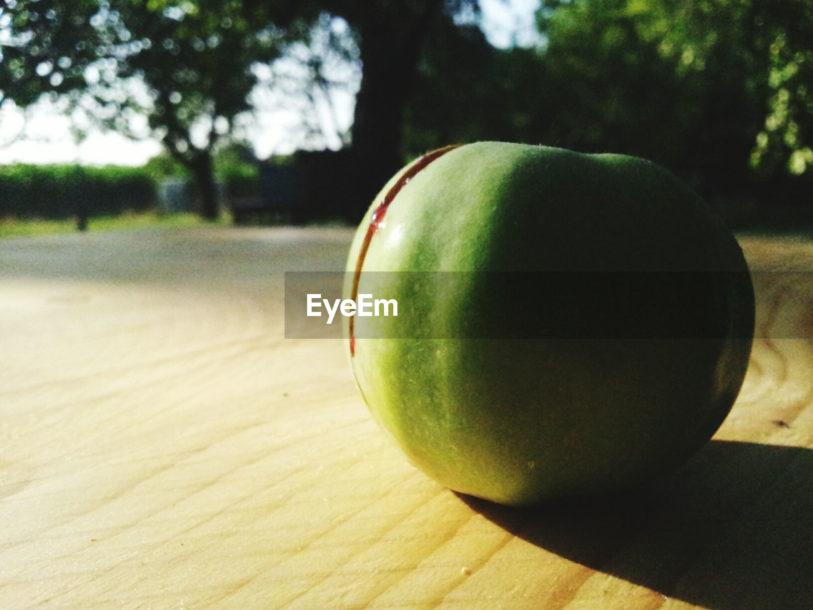 green color, close-up, food and drink, fruit, healthy eating, still life, focus on foreground, ball, grass, tree, green, field, freshness, table, apple - fruit, food, growth, wood - material, day, no people