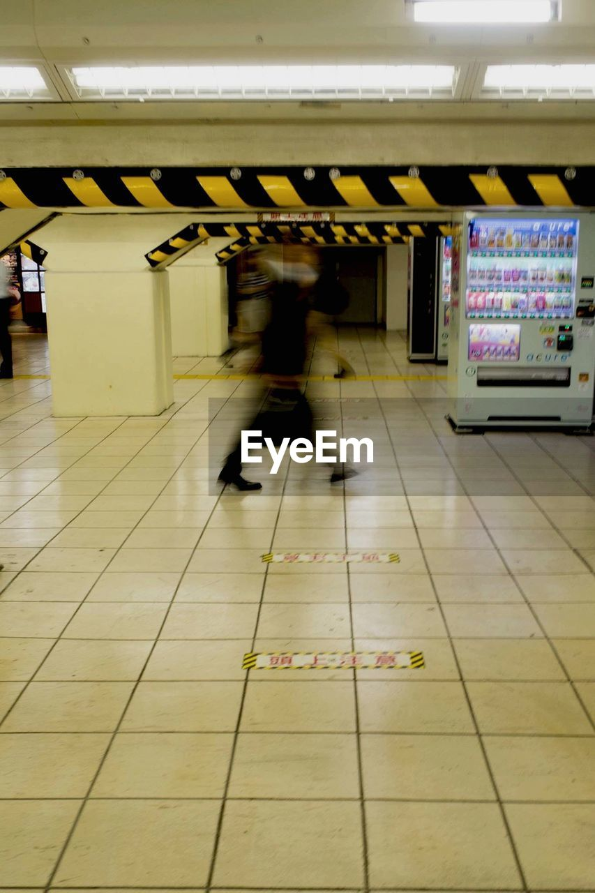 Blurred Motion Of Person Walking At Subway Station
