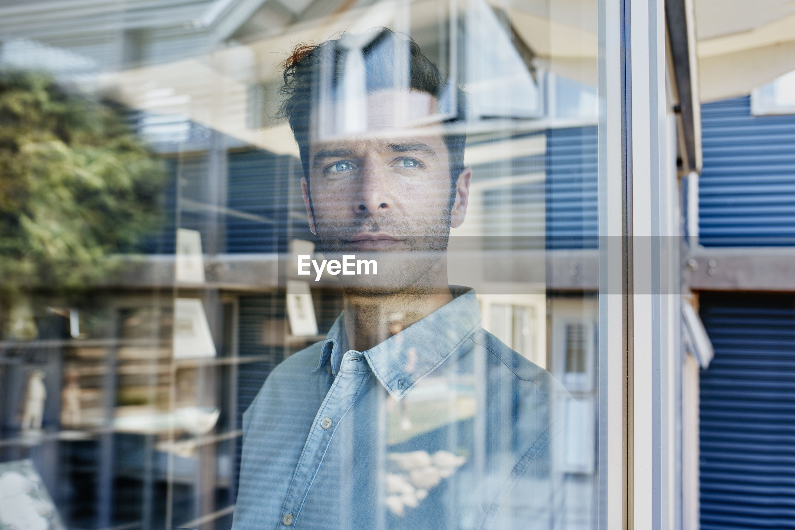 DIGITAL COMPOSITE IMAGE OF MAN WITH REFLECTION OF WINDOW