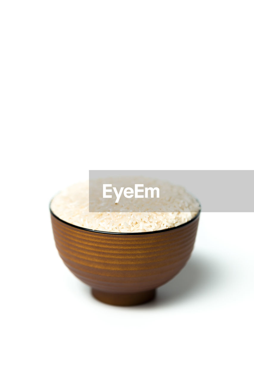 Close-Up Of Rice In Bowl On White Background