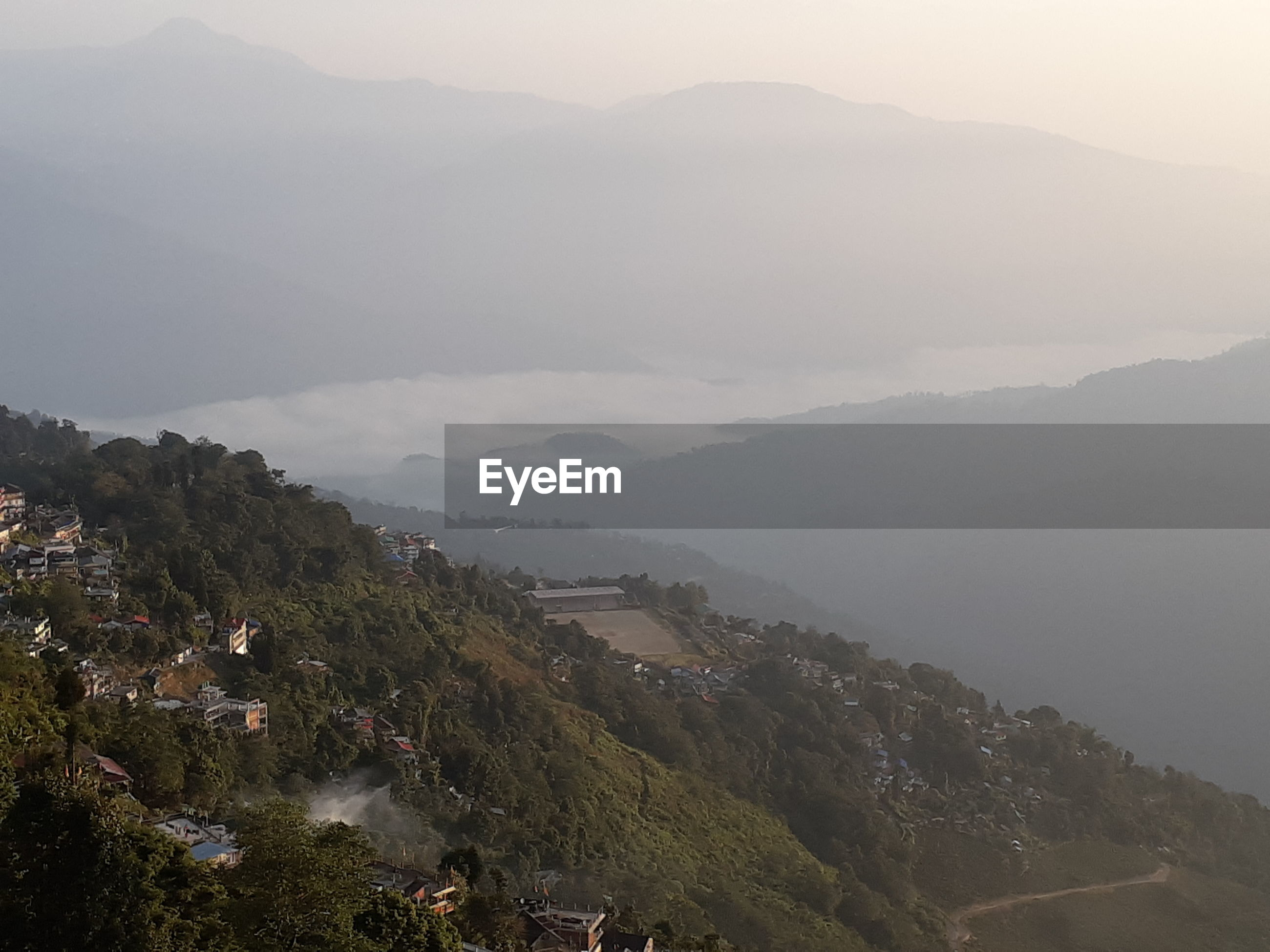 HIGH ANGLE VIEW OF LANDSCAPE AGAINST MOUNTAINS