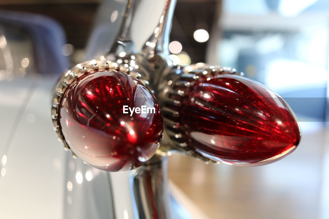 red, close-up, focus on foreground, indoors, no people, metal, still life, shiny, reflection, silver colored, table, sphere, selective focus, christmas decoration, decoration, day, steel, christmas, holiday