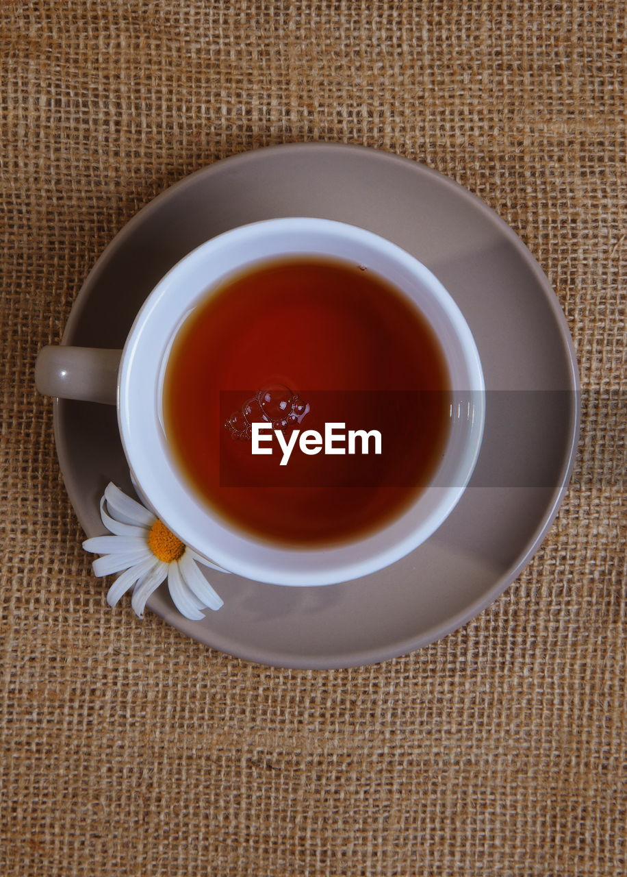 Directly Above Shot Of Tea Cup On Burlap