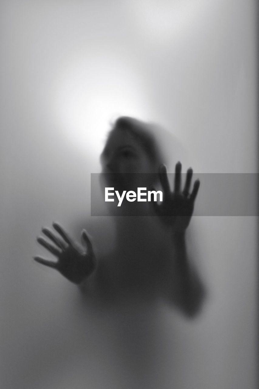 Woman Seen Through Glass Window