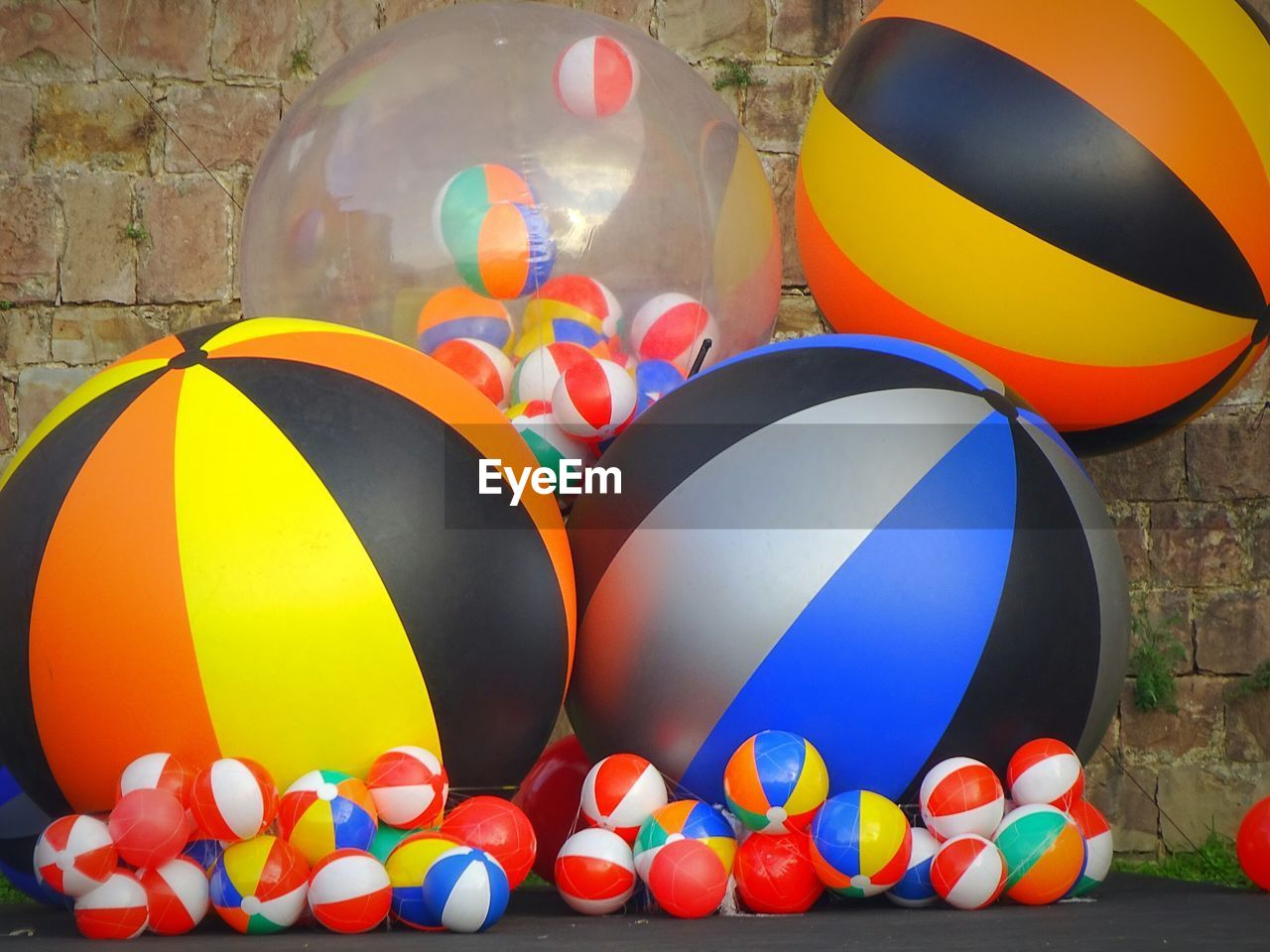 multi colored, balloon, celebration, no people, ball, still life, large group of objects, egg, day, variation, group, food, shape, close-up, outdoors, easter egg, abundance, choice, design, inflatable