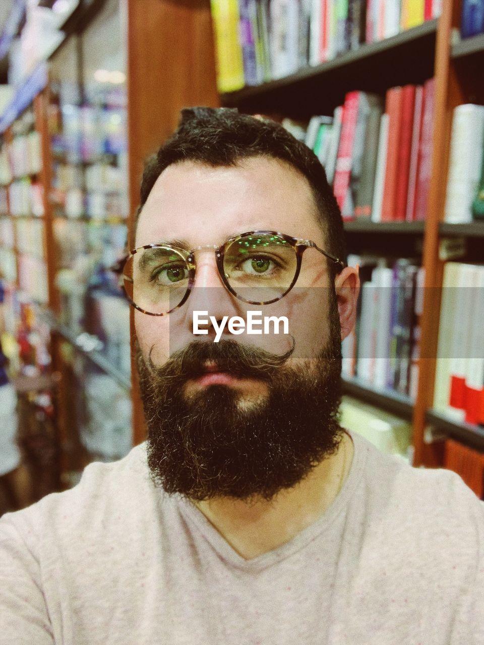 Portrait of bearded man in library