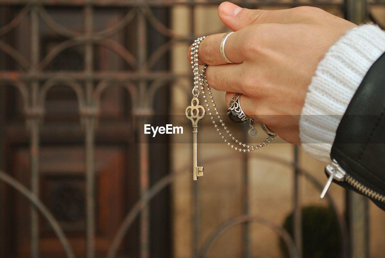 Cropped hand holding key