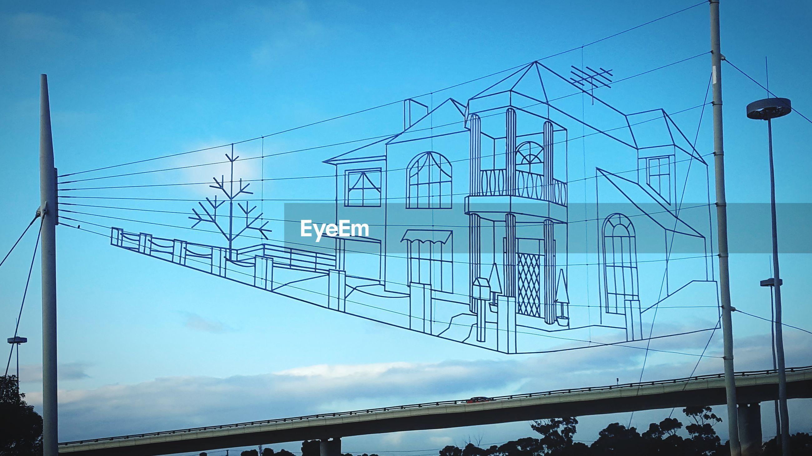 Digital composite image of house over bridge against sky
