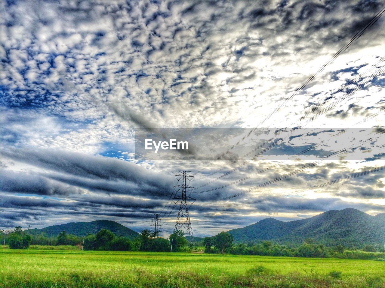 cable, electricity, power line, electricity pylon, cloud - sky, fuel and power generation, power supply, sky, technology, no people, connection, landscape, nature, field, scenics, outdoors, day, telephone line, mountain, tree, beauty in nature