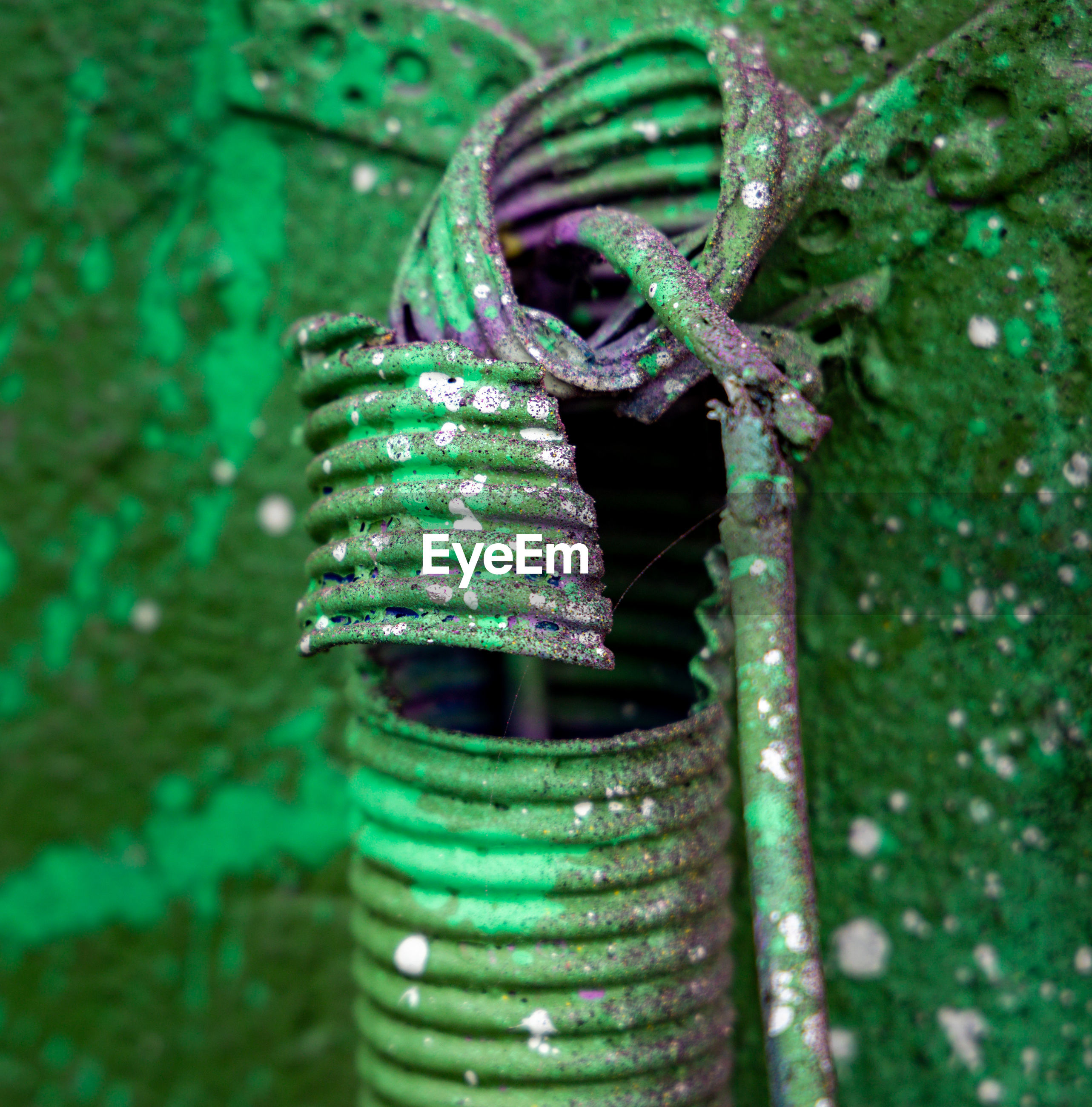 Close-up of electric wires on green graffiti background