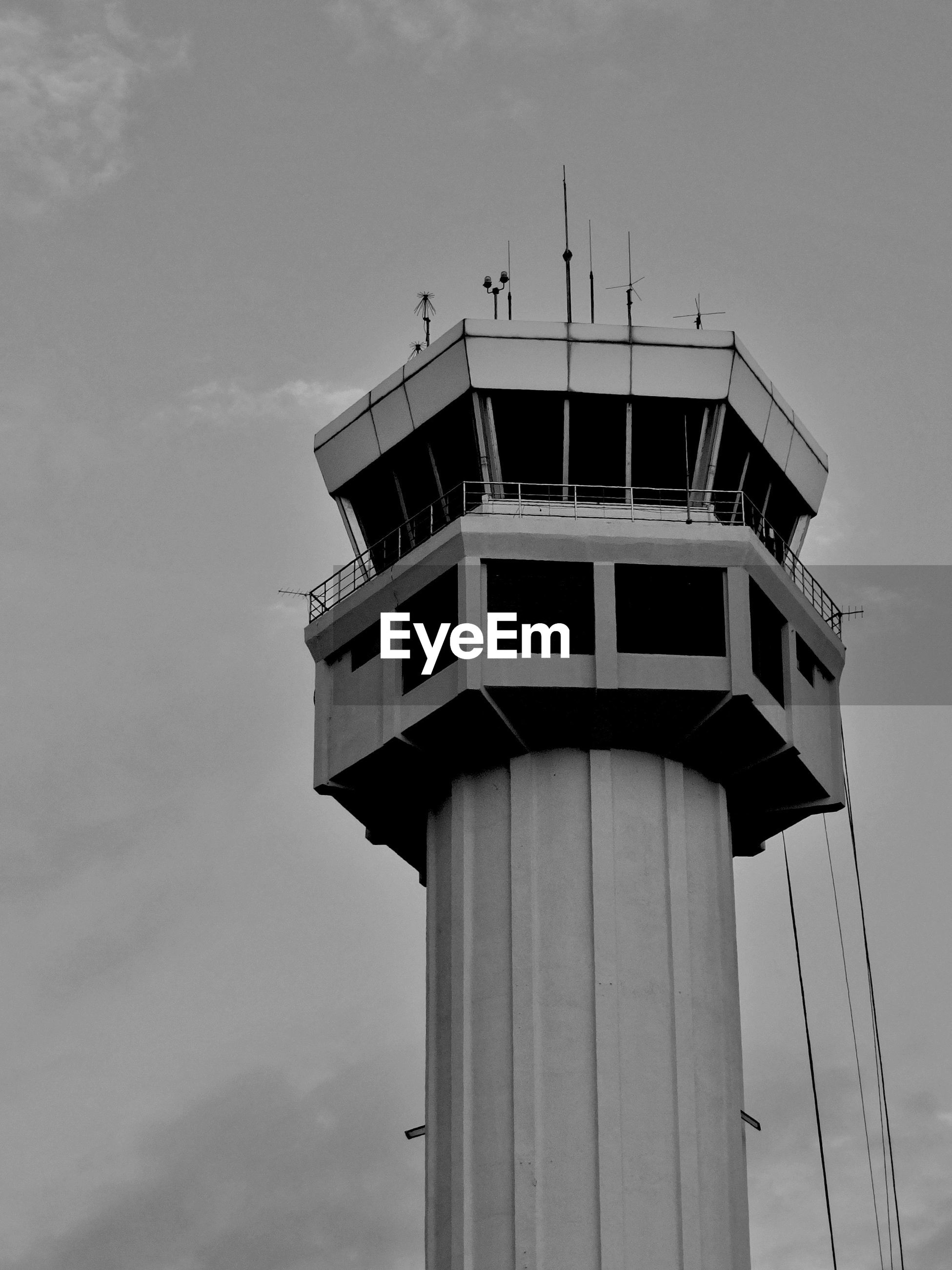Low angle view of air traffic control tower against sky