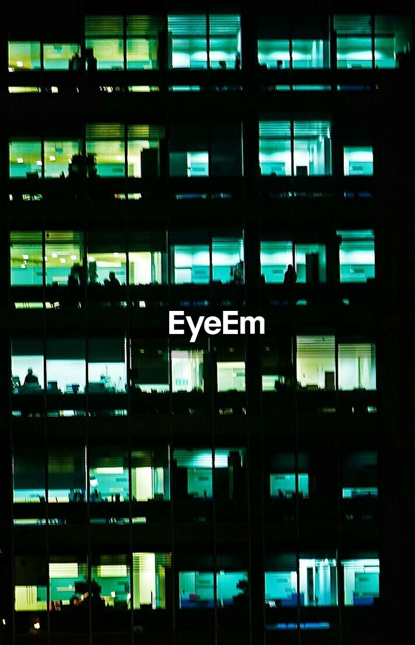 full frame, window, indoors, backgrounds, night, office, architecture, pattern, illuminated, no people, corporate business, built structure, modern, business, city, close-up