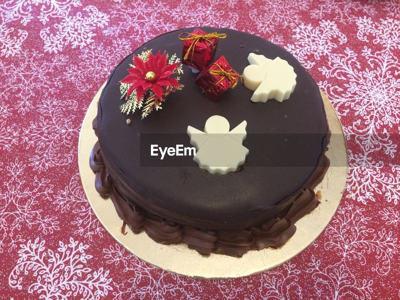 sweet food, indulgence, food and drink, dessert, food, freshness, indoors, plate, temptation, cake, no people, high angle view, table, flower, unhealthy eating, ready-to-eat, tablecloth, close-up, day