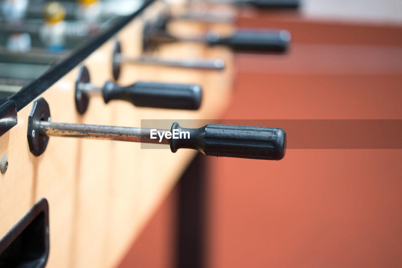 Close-up of foosball handle