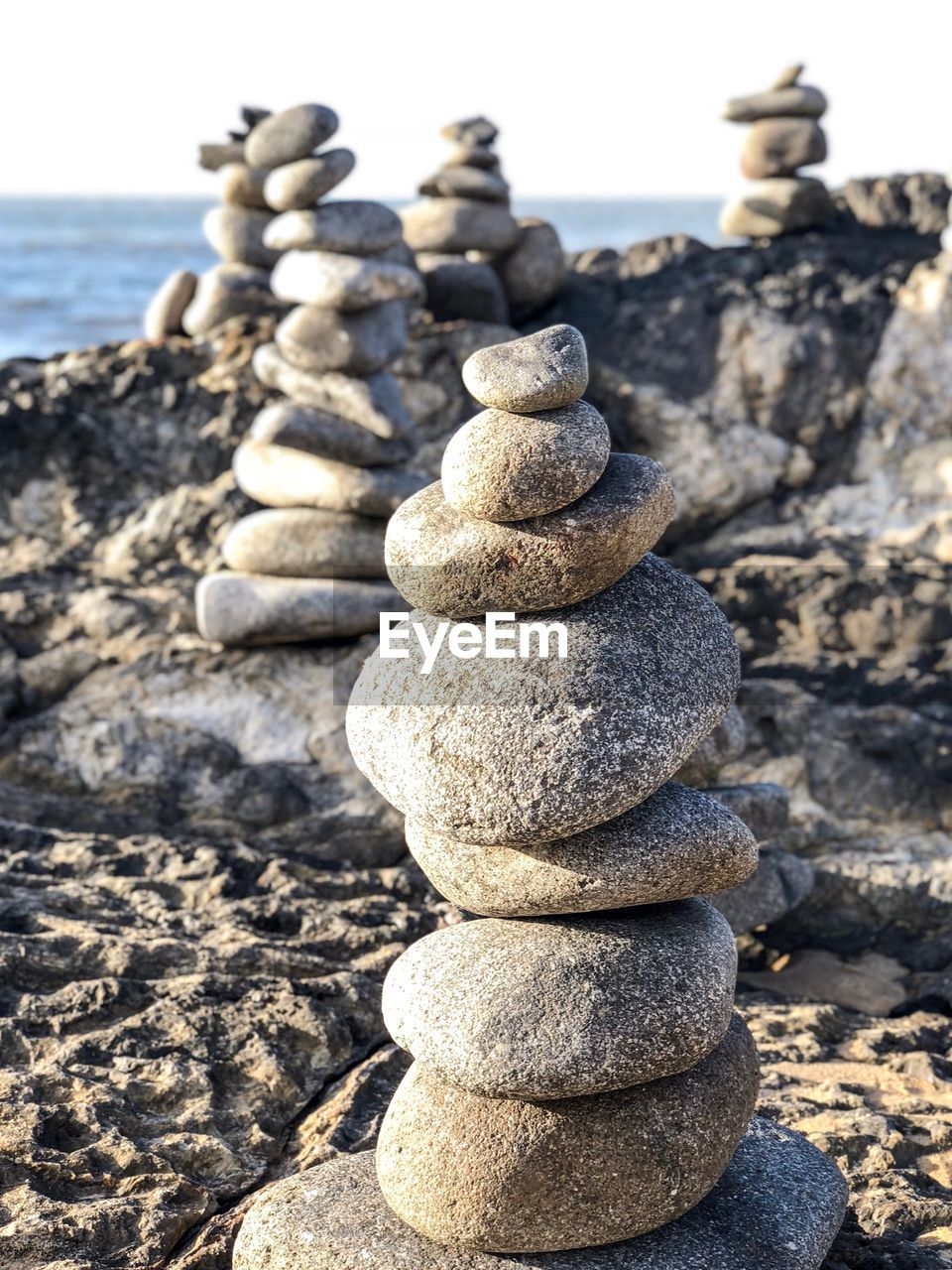 stack, balance, solid, rock, zen-like, stone - object, nature, rock - object, land, pebble, beach, tranquility, stone, focus on foreground, no people, sunlight, day, sky, water, tranquil scene, outdoors