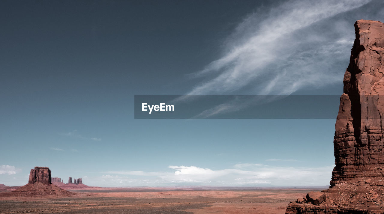 View of monument valley navajo tribal park against cloudy sky