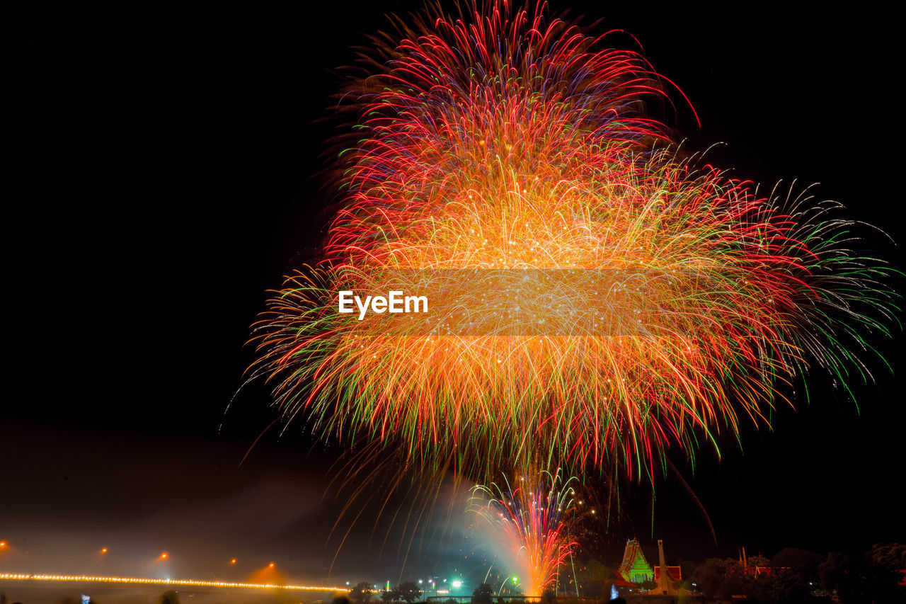 night, motion, firework, illuminated, celebration, event, firework display, arts culture and entertainment, long exposure, exploding, multi colored, glowing, blurred motion, sky, low angle view, firework - man made object, nature, no people, sparks, outdoors, light