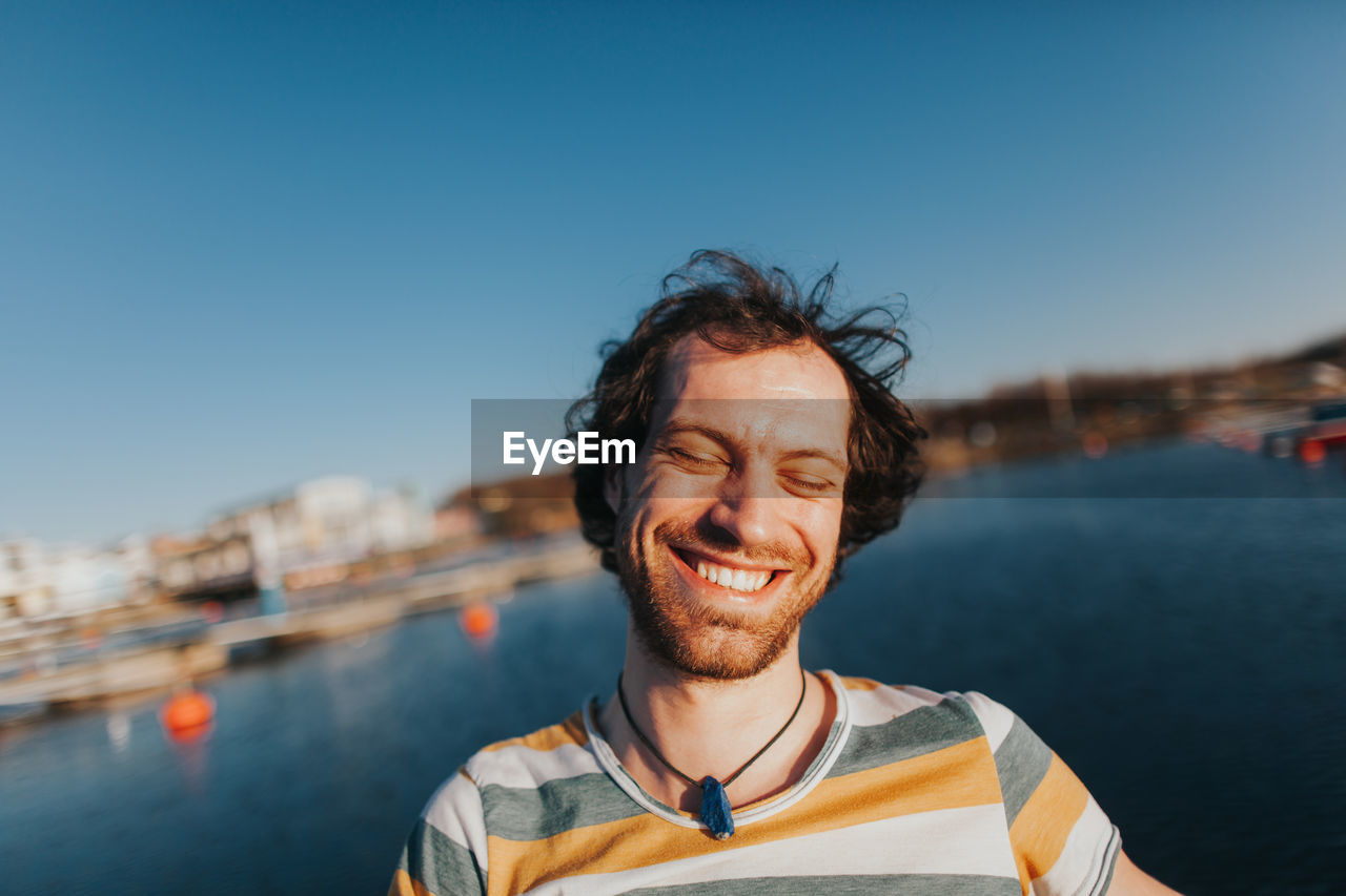 Smiling Man With Sea In Background
