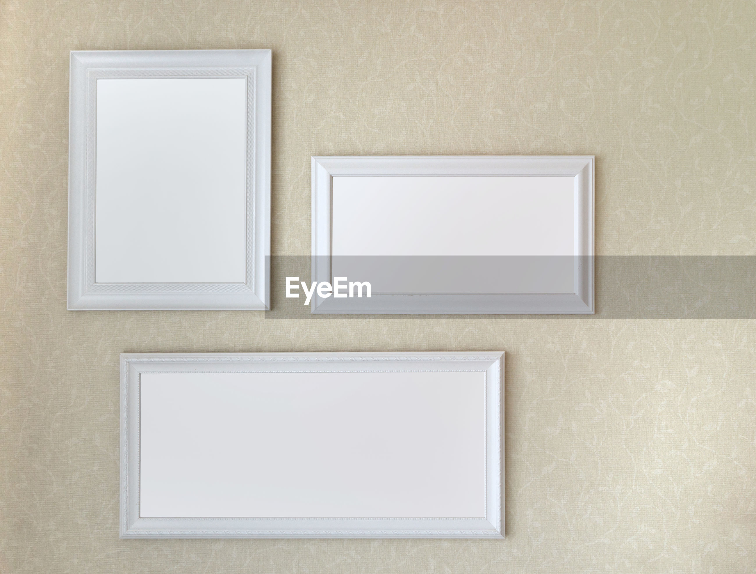 Blank picture frames hanging from wall