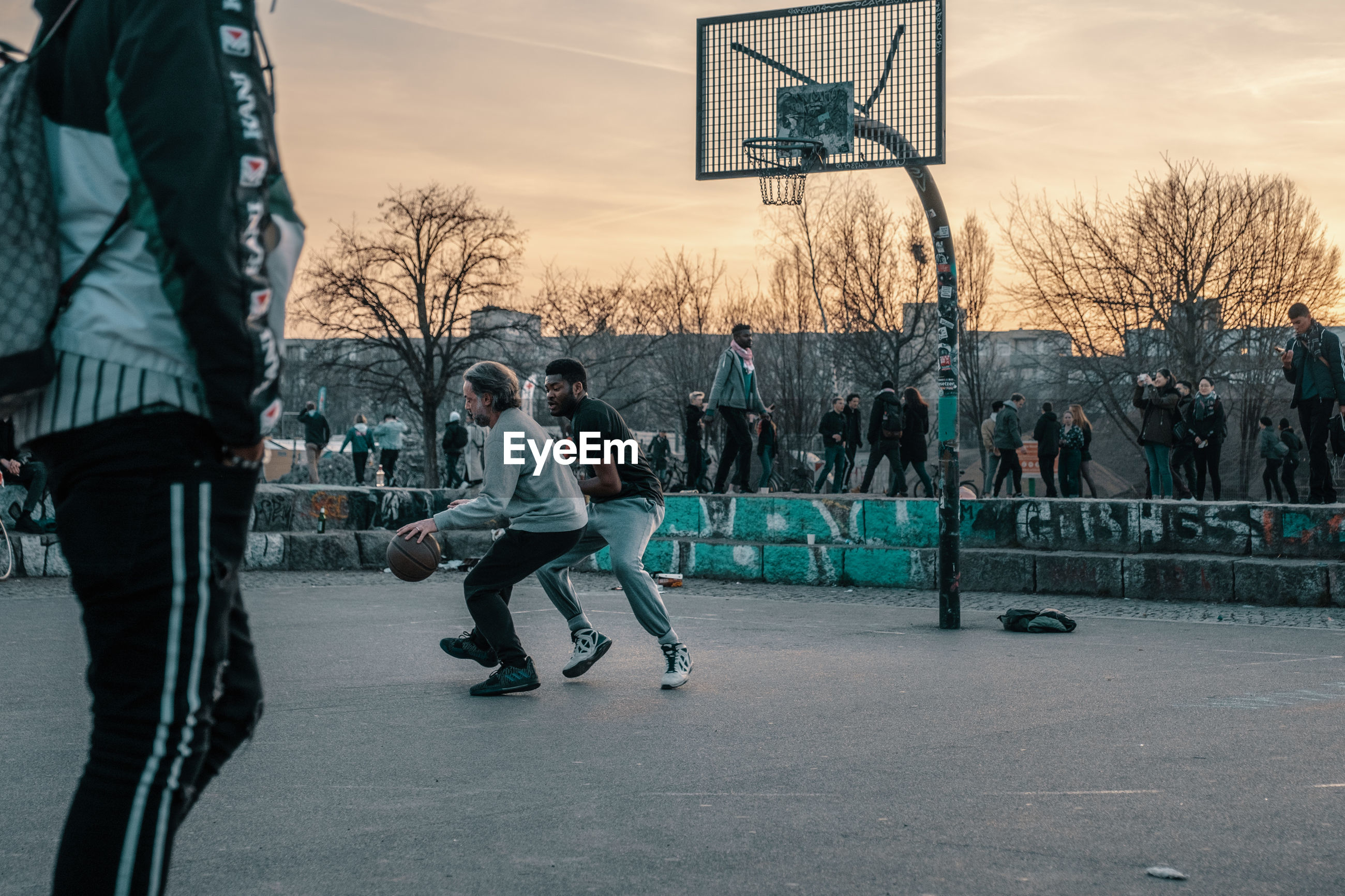 PEOPLE ON BASKETBALL COURT IN CITY