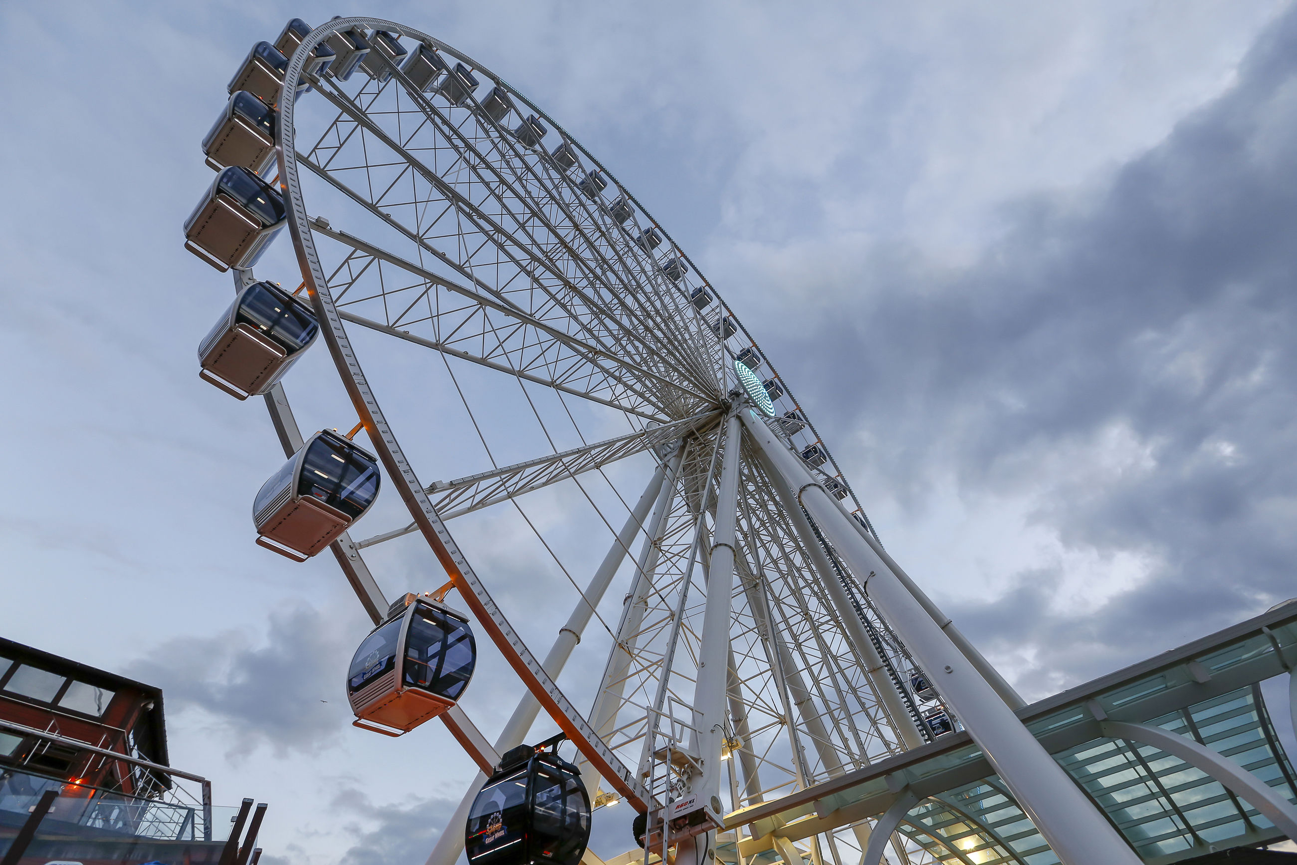 LOW ANGLE VIEW OF AMUSEMENT PARK AGAINST SKY