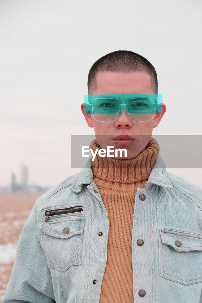 Portrait Of Young Man Wearing Eyeglasses Against Clear Sky