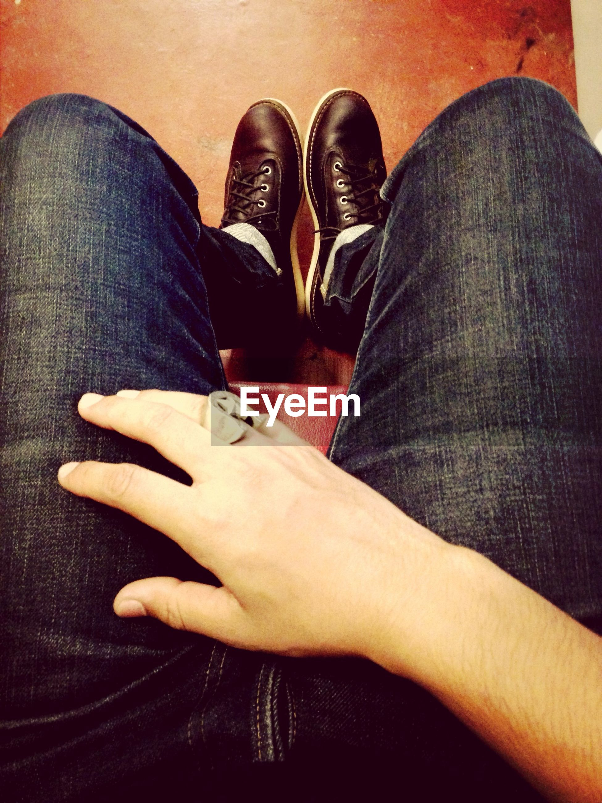 low section, person, shoe, lifestyles, jeans, men, leisure activity, personal perspective, togetherness, casual clothing, sitting, footwear, standing, human foot, bonding, relaxation