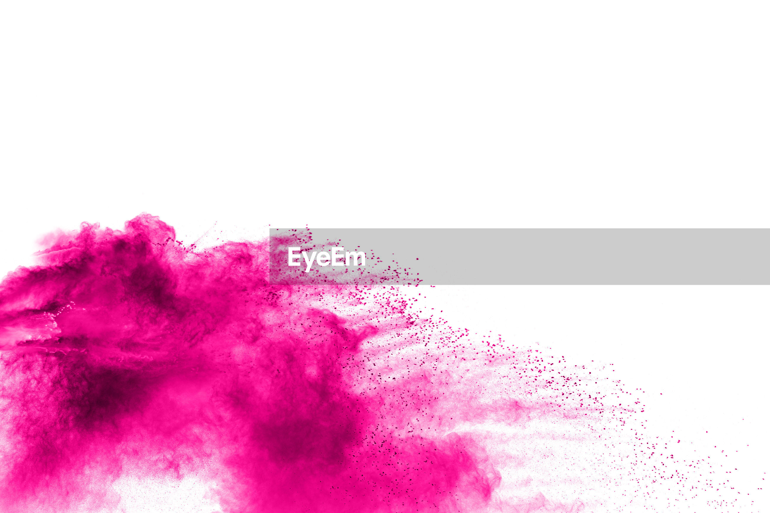 Pink powder paint exploding against white background