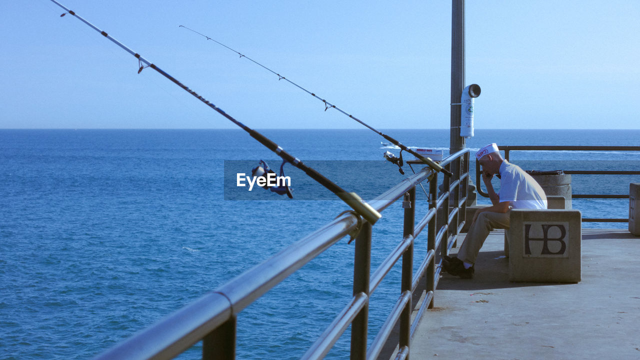 water, sea, sky, horizon, horizon over water, real people, nature, men, lifestyles, fishing, beauty in nature, day, leisure activity, clear sky, people, scenics - nature, fishing rod, activity, rod, outdoors