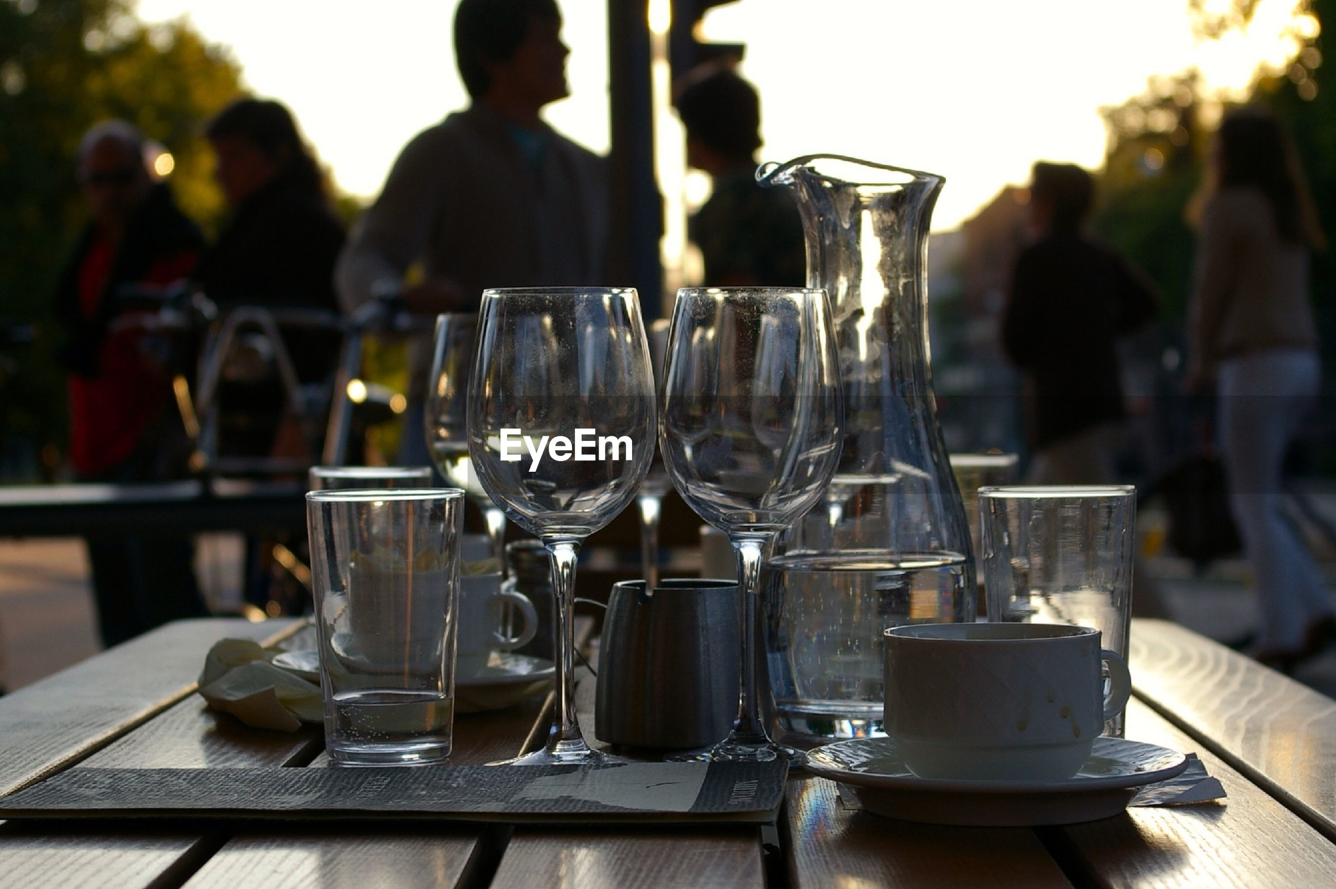 CLOSE-UP OF WINE GLASSES ON RESTAURANT