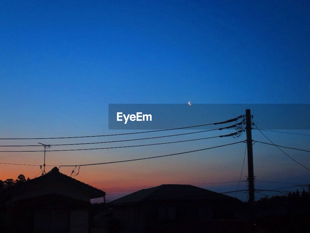 nature, copy space, silhouette, moon, connection, clear sky, sunset, cable, blue, no people, outdoors, beauty in nature, built structure, sky, scenics, building exterior, architecture, crescent, astronomy, day
